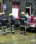 Clean-up operation in a house in Sussex during the floods in October 2000